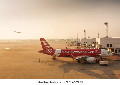 "BANGKOK,THAILAND-APRIL 28: ""Air Asia"" a low cost Asian airlines is waiting for take off in Don Muang international airport on April 28, 2015 in Bangkok, Thailand."