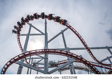 Bangkok,Thailand-April 3,2017 : People playing the Roller Coaster Track on background of blue sky and white cloud at Dream World amusement park  in bangkok ,Thailand.