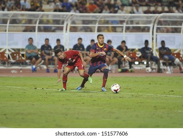 BANGKOK,THAILAND-AUGUST 7:Alexis Sanchez(R) of FC Barcelona in action during the international friendly match Thailand XI and FC Barcelona at Rajamangala Stadium on August7,2013 in,Thailand.