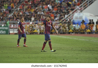 BANGKOK,THAILAND-AUGUST 7:Cesc Fabregas(R) of FC Barcelona in action during the international friendly match Thailand XI and FC Barcelona at Rajamangala Stadium on August 7,2013 in,Thailand.