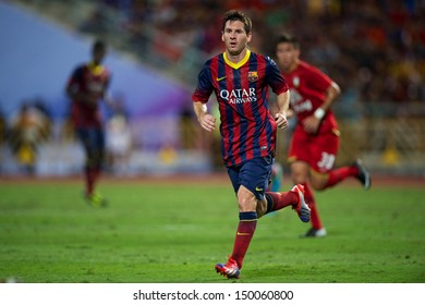 BANGKOK,THAILAND-AUGUST07: Lionel Messi #10 of Barcelona run during the international friendly match between Thailand XI and FC Barcelona at Rajamangala Stadium on August 7,2013 in,Thailand.