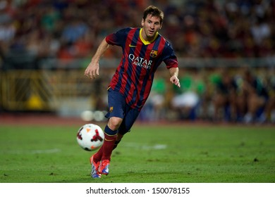 BANGKOK,THAILAND-AUGUST07:Lionel Messi of FC Barcelona run with the ball during the international friendly match  Thailand XI and FC Barcelona at Rajamangala Stadium on August 7,2013 in,Thailand.