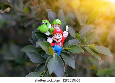 Bangkok,Thailand-circa Jan 2019: the characters of super Mario bros games by Nintendo climbing on the tree with fun and happy