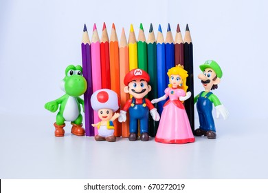 BANGKOK,THAILAND-CIRCA JUL 2017:Mario character stand in front of the wall of pencil color.Pencil color or pen color made by wood and insert color inside that children or the artist use for painting.