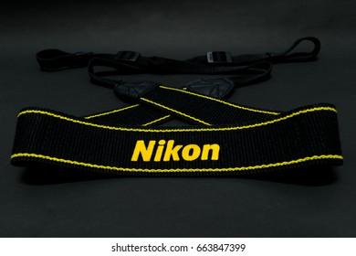 BANGKOK,THAILAND-CIRCA JUN 2017: Nikon camera strap on the black background. This is the camera brand from japan company to supply camera for international.