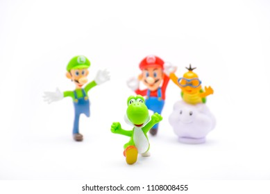 BANGKOK,THAILAND-CIRCA JUN 2018: Mario character team perform racing running with fun. The dragon is lead his friend on the white ground and Mario friend are encourage the dragon with fun.