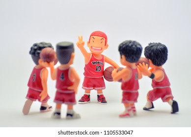 BANGKOK,THAILAND-CIRCA JUN 2018: Mini model or figures of famous Japanese cartoons call Slam Dunk in action of talkin meeting of basketball plan or tactics with captain and his team to make win.