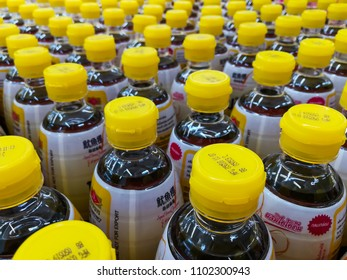 Bangkok,THAILAND-CIRCA MAY 2018: Yellow cap of fish sauce bottles arrange in row preparing for sell in supermarket of Thailand