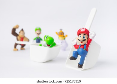 BANGKOK,THAILAND-CIRCA SEP 2017: Super Mario character nintendo games playing on the white background same as play yard with green dragon, monkey and others with fun.