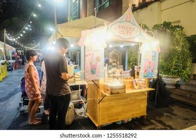 BANGKOK,THAILAND-December 2018-People and Tourist buying food at outdoor street food night market. Market Stalls. Outdoor market. Food Event. Food Fair. Festival. Flea Market. Shopping. Dessert Shop.