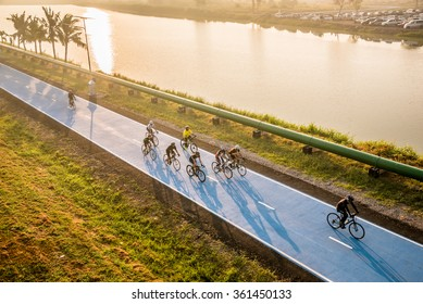 Bangkok,Thailand-December 27, 2015 : Unidentified people bicyclists biking in motion at sky blue bicycle lane at Suvarnabhumi Airport in Bangkok ,Thailand.The track length 23.5 Kilometers per round.