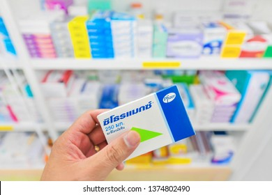 Bangkok,Thailand-February 23,2019: Pharmacist holding Zithromax box from Pfizer and many medicines on shelf in pharmacy drugstore.Zithromax is used to treat many different kinds of bacterial infection