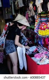 Bangkok,Thailand-February 5,2017: Young vietnamese girls while choosing bra size and underwear in clothes shop at cheap JJ market that famous and celebrated tourist attraction.