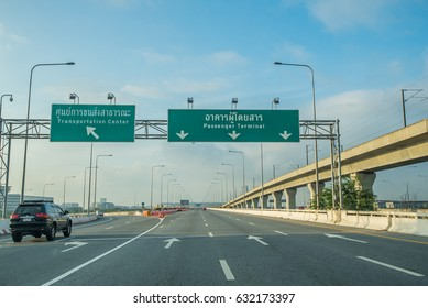 Bangkok,Thailand-January 13,2017 : The scene of street sign to passenger terminal at Suvarnabhumi Airport in Bangkok ,Thailand.