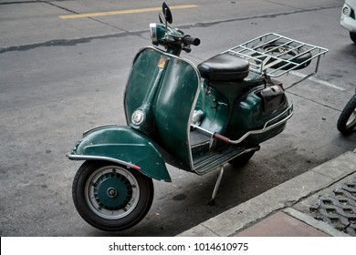 Bangkok,Thailand,January 23 2018 : Dark green classic vespa motor bike on the street in Leather market,Vintage scooter