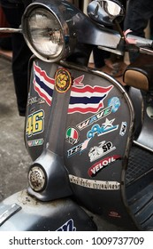 Bangkok,Thailand,January 23 2018 : Gray classic vespa motor bike on the Street in Leather market,Retro scooter decorated with stickers and labels
