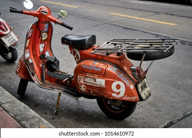 Bangkok,Thailand,January 23 2018 : Orange classic vespa motor bike on the street in Leather market,Vintage scooter