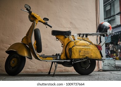 Bangkok,Thailand,January 23 2018 : Yellow classic vespa motor bike on the Street in Leather market,Vintage scooter