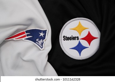 BANGKOK,THAILAND-JANUARY 28: Logo of  AFL Team Pittsburgh Steelers and New England Patriots on AFL Fabric For NFL Super Bowl 2018 Final on January 28,2018