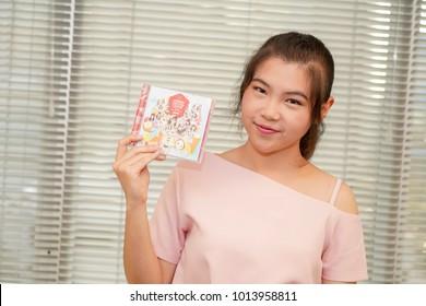 BANGKOK,THAILAND-JANUARY 31 :Ota or Fan of BNK48 holding BNK48 Koisuru Fortune Cookie Cd on January 31,2018