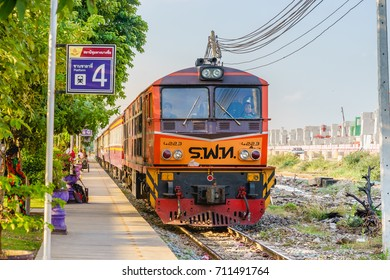 Bangkok,Thailand-JUL 31, 2017 : Red orange train,Diesel locomotive at the Bangsue station platform no.4. BangSue Junction is a railway station and junction located in Bangkok.