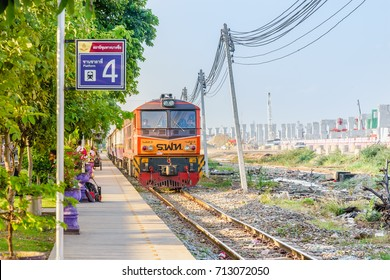 Bangkok,Thailand-JUL 31, 2017 : Red orange train,Diesel locomotive at the Bangsue station platform no.4. BangSue Junction is a railway station and junction located in Bangkok.Selective Focus at train.
