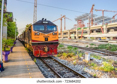 Bangkok,Thailand-JUL 31, 2017 : Red orange train,Diesel locomotive at the Bangsue station platform no.4. Near Construction site of sky train red line from Bangsue to Rangsit. Selective Focus at train.