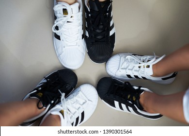 Bangkok,Thailand,July 18,2018-Pairs of black and white color sneaker adidas shoes in three sizes