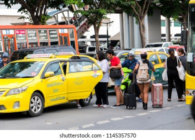BANGKOK,THAILAND-JULY 26,2018:Many people are waiting for the taxi on street one day before the long weekend The Buddhist Lent Day at BTS chatuchak station Phahonyothin road chatuchak Bangkok,Thailand