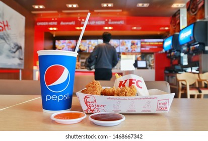 Bangkok,Thailand-July 30,2019:KFC fried chicken and Pepsi water are placed on the table in the shop in Bangkok, Thailand.