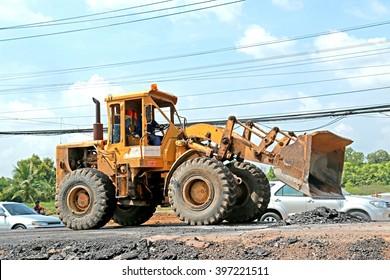 BANGKOK-THAILAND-JULY 7 : The loader for construction the road on July 7, 2015 Bangkok, Thailand