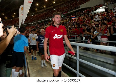 BANGKOK,THAILAND-JULY13: Michael Carrick (L)of Manchester United in action during the friendly match between Singha All Star and Manchester United at Rajamangala Stadium on July 13, 2013 in Thailand.