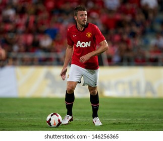 BANGKOK,THAILAND-JULY13: Michael Carrick of Manchester United in action during the friendly match between Singha All Star XI and Manchester United at Rajamangala Stadium on July 13, 2013 in Thailand.