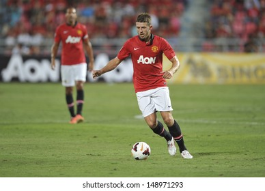 BANGKOK,THAILAND-JULY13: Michael Carrick(R)of Manchester United in action during the friendly match between Singha All Star and Manchester United at Rajamangala Stadium on July 13, 2013 in Thailand.