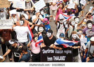 BANGKOK,THAILAND-JUNE 2 : Demonstrators from the anti-government V for Thailand group wear Guy Fawkes masks to protest against the government at the Central World on June 2,2013 in Bangkok, Thailand.