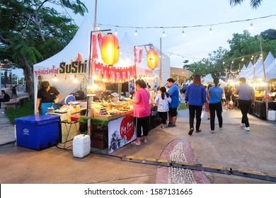 BANGKOK,THAILAND-June 2019-People buying Japanese food at Sushi restaurant. Outdoor street food night market. Market Stalls. Outdoor market. Food Event. Food Fair. Festival. Flea Market. Bazaar
