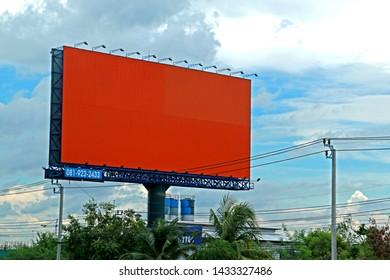 BANGKOK-THAILAND-JUNE 24 : The Advertise Billboard near the road in the city of Bangkok, June 24 2016, Bangkok, Thailand