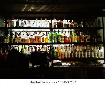 Bangkok/Thailand-June 27,2019: Many kinds of liquor bottles on shelves of the bar counter.