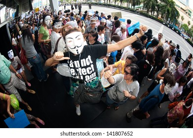 BANGKOK,THAILAND-JUNE 9 : Unidentified demonstrators from the ant i- government  V for Thailand group wearing  Guy Fawkes masks attend rally outside a shopping mall on June 9,2013 in Bangkok,Thailand.