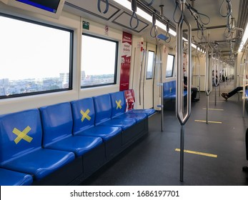 BANGKOK/THAILAND-Mar 29, 2020: Measure against COVID-19.Social distancing inside a MRT subway train. Yellow cross symbol on a seat means one shall not sit there.Infection control.