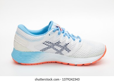 Bangkok,Thailand-March 13,2019:ASICS Running Shoes Road Hawk FF2 isolated on white,ASICS is a Japanese multinational corporation athletic equipment company which produces footwear and sports equipment