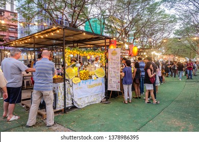 BANGKOK,THAILAND-March 2019-People and Tourist buying food and drinks at outdoor street food night market in the Park. Market Stalls. Outdoor market. Food Event. Food Fair. Festival.Flea Market.Bazaar