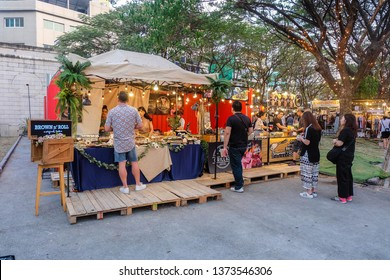 BANGKOK,THAILAND-March 2019-People and Tourist walking, buying food at outdoor street food night market in the Park. Market Stalls. Outdoor market. Food Event. Food Fair. Festival. Flea Market. Bazaar