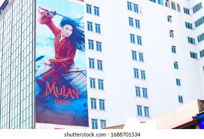 Bangkok/Thailand-March 31 2020: The Mulan from Disney big billboard commercial advertising in Chinatown Bangkok : ( actress is Liu Yifei ) Movie is postponed and boycott from some countries . China