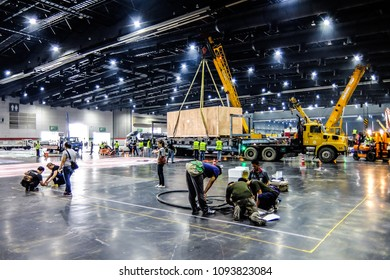 BANGKOK,THAILAND-MAY 14 :many workers prepare set up and in stall heavy machine for  Intermach 2018 an event manufacturing machine shows in BITEC Exhibition hall