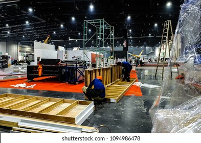BANGKOK,THAILAND-MAY 20 ,2018 :many carpenters tear down booth for move out from  Intermach 2018 an event manufacturing machine shows in Bitec Exhibition hall Bangkok,Thailand
