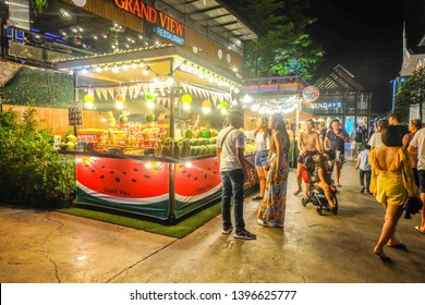 BANGKOK,THAILAND-May 2019-People and Tourist buying food and drinks at Asiatique outdoor street food night market. Market Stalls. Outdoor market. Food Event.Food Fair. Festival.Flea Market.Bazaar