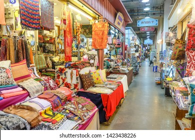 BANGKOK,THAILAND-May 2019-Souvenir Shop selling Thai Fabric. Product of Thailand at Asiatique outdoor street food night market. Market Stalls. Outdoor market. Festival. Flea Market. Bazaar.