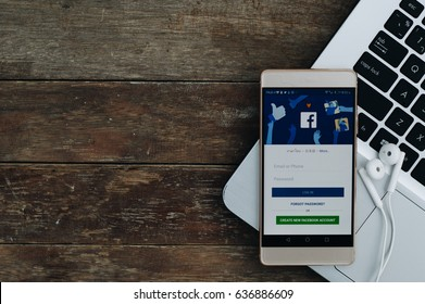 BANGKOK,THAILAND-May 9,2017:he Facebook application is launching on smartphone The login screen is showing.Facebook is the social application that connects people together online./Vintage concept