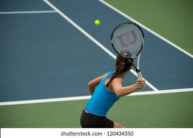BANGKOK,THAILAND-NOV  29  : Hong Kong tennis player Wing-Yau Venise Chan returns a serve at semi final match in Chang ITF Pro Circuit 2012 on November 29,2012 at Rama Garden Hotel in Bangkok,Thailand.